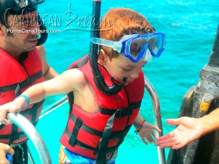 little boy snorkeling